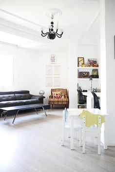 A Kids Table Shares Space In This Bright Spanish Living Room With Dual  Workspaces. Bohemian