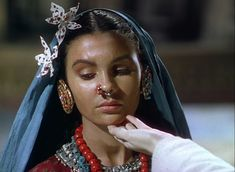 """Kanchi (Jean Simmons) is inspected on her arrival at the convent in """"Black Narcissus""""."""