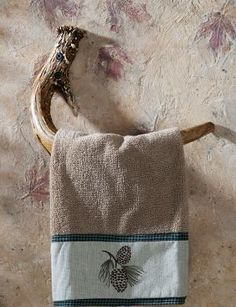 towel holder made with an antler - how about toilet paper like the leaves in the plaster too