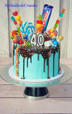 Blue chocolate drip cake with candy