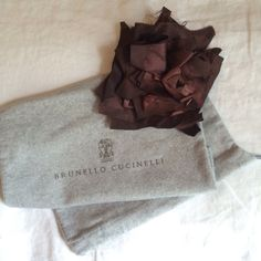 Brunello Cucinelli Brooch Pin NWT Beautiful flower pin by Brunello Cucinelli. Made from silk and leather. The silk has a marbleized effect/ print on it. New and in excellent condition. Comes with tags and original packaging. brunello cucinelli Jewelry Brooches