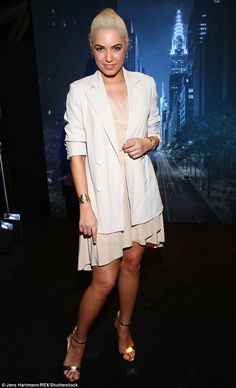 Blonde beauty: Amber Le Bon looked every inch the slick spinner as she arrived at the Tiff...