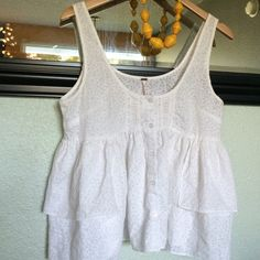 Free people ruffle tank Adorable ruffled free people tank. Cute buttons with a patterned ruffle bottom. Gorgeous. Free People Tops Tank Tops