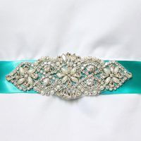 From traditional to bohemian, floor-length to tea-length, A-line to ball gown, the dress a bride chooses for her wedding day is an important personal reflection of her unique. Diy Wedding Sash, Wedding Belts, Diy Wedding Flowers, Bridal Sash, Wedding Jewelry, Wedding Ideas, Wedding Crafts, Diy Flowers, Wedding Stuff