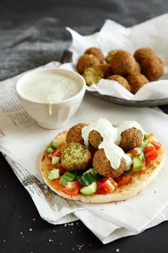 pita with tomatoes and cucumbers, falafel and tahini (all veggie)