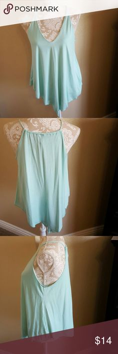 Mint Tank Size L Beautiful Mint Tank Size L but fits like a M Cute uneven hem line and is fully lined in the front Flattering v neck. Excellent condition worn once Boutique Tops Tank Tops