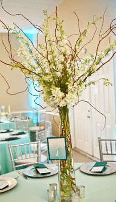 Wedding reception decor on pinterest curly willow tall for A decoration that is twisted intertwined or curled