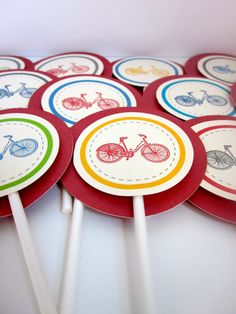 Cupcake Toppers: These adorable cupcake toppers feature several different vintage bicycle designs and come in lovely shades of red, blue, green, yellow, and charcoal gray. Each bicycle is 3-D mounted onto a vibrant red backing and finished off with a heavy duty lollipop stick.