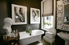 Dark walls w/the white, prints over tub, window treatment...could do w/o the bust though.