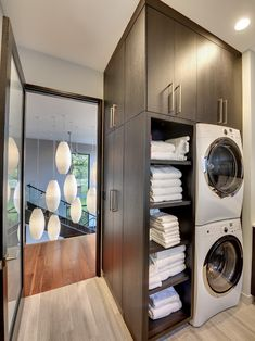 Contemporary Laundry Room Design, Pictures, Remodel, Decor and Ideas: linen storage near washer/ dryer closet