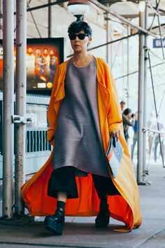 The Benefits & Joys Of A Really, Really Good Coat #refinery29  http://www.refinery29.com/vintage-style-coat#slide-2  This dramatic orange one can double as a superhero cape....