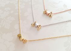 Personalized Initial Necklace, Dainty Gold Letter Necklace, Bridesmaid Gift, Monogram Jewelry by MignonandMignon on Etsy https://www.etsy.com/listing/220015066/personalized-initial-necklace-dainty