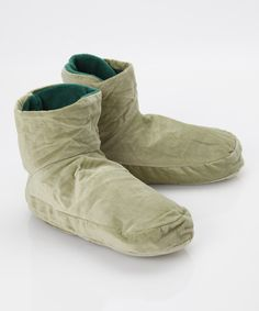 Partake in the soothing powers of heat and aromatherapy with these cuddly foot cozys. These comforting foot coverings can be frozen or microwaved to cool or heat and release the relaxing scents of clove, cinnamon and eucalyptus.11.5'' W x 6.5'' H x 3.25'' DFabric: 100% polyesterFill: rice / clove / cinnamon / eucalyptus...