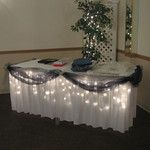 Navy Blue and White Wedding- Under lighted and navy blue decorated gift table.- instead of navy we could do purple and green!