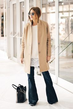 9 Ultra-Cool Ways To Wear Flared Jeans // Maja Wyh in a camel coat, layered tops & wide-leg denim #style #fashion #blogger