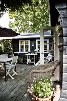 cozy outdoor space. ++ katrine martensen-larsen Love the WHITE FRAMING and the natural wood Looks awesome maybe I can do at our home...I keep trying to get Steve on board with the Glass doors soo pretty!