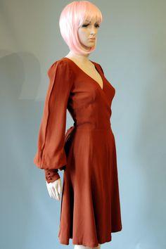 Original Biba 1970s Vintage Crepe Bishop Sleeve Cross Over Bodice Dress. £260.00, via Etsy.