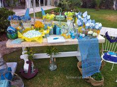 Candy bar και τραπέζι ευχών ταυτόχρονα σε χρώματα κίτρινου και σιέλ με θέμα θαλασσινό