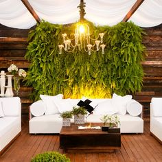 wedding cocktail lounge with white furniture and greenery