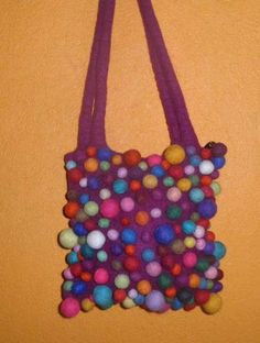 Felt wool crafts, felt bags purses, felt accessories, felt ball rugs and much more felt related DIY & crafts we can make and export to any destination around world. visit: http://www.nepalartshop.com/felts.php