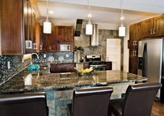 Updated Hunting Lodge kitchen. Exotic blue granite, blue and gray glass tile, knotty alder cabinetry.