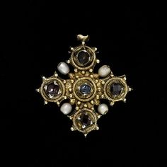 Pendant Reliquary Cross c. 1450-1475, made of silver, ruby, sapphire, garnet, & pearl. Medieval jewelry reflected an intensely hierarchical and status-conscious society. Royalty & nobility wore gold, silver and precious gems. Humbler ranks wore base metals, such as copper or pewter.