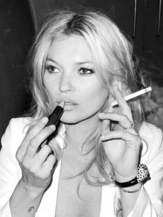 Now that's talent. Lipstick in one hand, cigarette in the other. Here's Kate Moss while at Cannes Film Festival