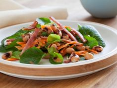 Bacon and peas are a classic combination; try putting them together with fresh vegetables and a vinaigrette to create this satisfying Black-Eyed Pea Salad with Canadian Bacon.