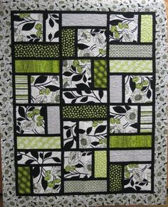 This would be so cool to sub a tee shirt in the big square for a t-shirt quilt!! DeNovo Quilt... simple but I love this!
