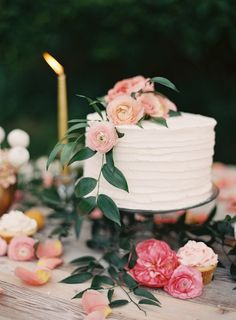 Simply frosted cake topped with fresh blooms