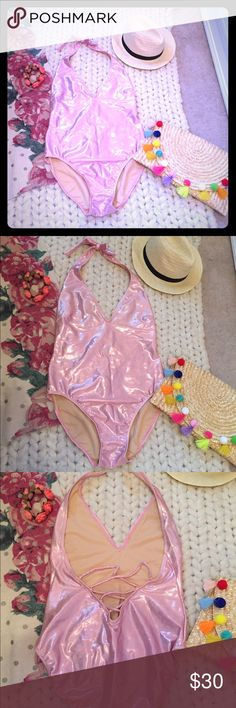 Newport News Lace-up Swim Suit Pink iridescent sexy halter style swimsuit with lace up scoop back and v-neck front. Shimmer like a mermaid in this hot suit! Like brand new; worn once on a romantic vacation with the husband. I lounged by the pool and it hasn't even been exposed to water. I added a photo-size 12 and true to size (but too much post baby cleavage for me!) A perfect pick to look sexy and chic at the pool this summer. Newport News Swim One Pieces