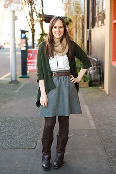 I love the belted circle skirt!  All of her layering is great.
