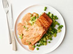 Broiled Salmon With Tomato Cream Sauce recipe from Food Network Kitchen via Food Network
