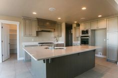 Pepperdign Homes - Catalina Mapleton. White Countertops, Walk In Pantry, Home Kitchens, Homes, Cabinet, Highlands, Furniture, Home Decor, Clothes Stand