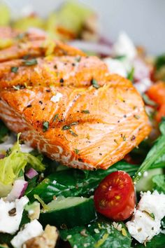 Salmon Greek Salad with Lemon Basil Dressing - A light and healthy recipe that tastes amazing! Crisp vegetables are tossed in a tangy lemon basil dressing and topped with flaky salmon. Tuna Fish Salad, Grilled Salmon Salad, Salmon Salad Recipes, Greek Salad Recipes, Vegetarian Salad Recipes, Salad Recipes For Dinner, Lemon Recipes, Healthy Salad Recipes, Healthy Eats