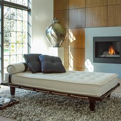 DUNKIRK-a daybed made in North Carolina, covered in a cotton fabric woven in Pennsylvania and trimmed in a domestic leather, tanned in Maine. Comfort. Quality. Style. Available at VALOR American Home.