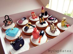 Makeup, perfume, shoes & bags chocolate cupcakes covered with a vanilla icing..