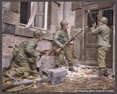 Three soldiers (possibly the 1st Battalion) of the 117th Infantry Regiment, 30th US Infantry Division breaking down the door of a house in the Belgian town of Stavelot in search of a German sniper. 18th December 1944.
