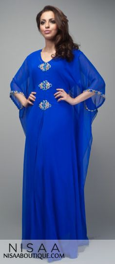 Lavish Zaffre- The Lavish Zaffre dress is glamorous in style and sophisticated. The dress has a V neck line with pleated detail for a flattering look. The centre chest to waistband is embellished with shimmering sapphire blue and gold colour crystals. The dress has a floaty outer layer of chiffon which gives the soft, feminine look. The dress is fully lined. It comes with a inner layer belt which can be adjusted according to individual size. Length from neckline to hem is between 60-65…