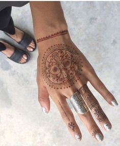 Etched sterling silver ring & pretty henna body art.
