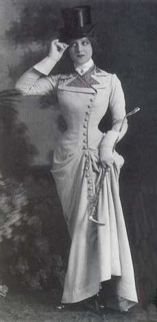 """Note 1890s equestrian fashion. Note the top hat. Some of the fashions of steampunk seem inspired by the slimline darker colored habits of the 1880s with their high buttoned bodices and trousers rather than petticoats, and then to the 1890s equestiran with longer jackets and """"leg of mutton sleeves"""""""