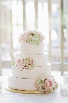pretty white and pink wedding cake; photo: Kelly Kollar Photography