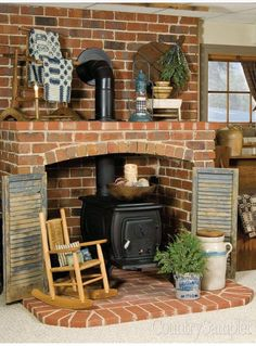 Pot belly stove in brick surround with space for spare wood - Stove Fireplace, Fireplace Wall, Living Room With Fireplace, Fireplace Mantels, Fireplace Ideas, Fireplaces, Wood Stove Surround, Brick Hearth, House With Balcony