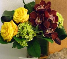 Modern and sophisticated design featuring burgundy cymbidium orchids. $75.00