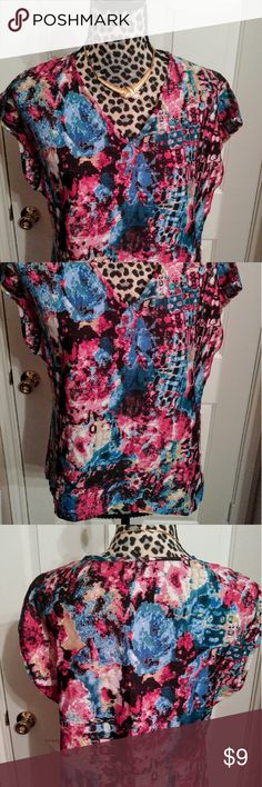 Live 4 TRUTH I have a gently used top, designed by Live 4 Truth. The top is  in size a size medium. The fabric is made of 100% polyester. If you're interested feel free to respond. Take care. Love 4 TRUTH Tops Blouses