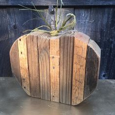 Just in time for fall, you can have this chunky little beauty (or more) sittin' on your front porch with fall flowers and decor! Each pumpkin is made from reclaimed wood, raffia and an actual tree bra