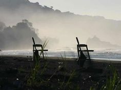 Early morning on Dominical beach, lifeguard chairs silently wait for the day.    #dominicallifegaurds #watersafety #costarica  www.sunsetsurfdominical.com