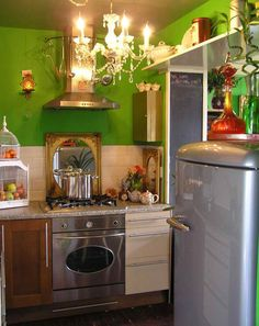 Small eclectic kitchen. I love the birdhouse for fruit/veggie storage.
