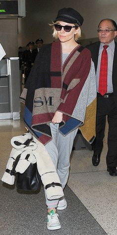 """- Sienna Miller from #InStyle  I don't care if your """"poncho jacket"""" is Burberry.  This still looks like a sloppy mess!"""