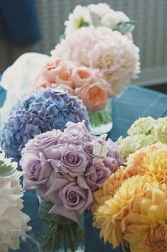 An excellent example of varying types of flowers in different colors which blend beautifully together. Each color is of the same variety/type of flower - each with their own unique bloom structure, look and feel. There is no need to work with strictly one type of flower - branch out and add variety to your wedding flowers!